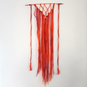 Macramé wandhanger oranje rood