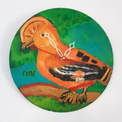 Klok van oude elpee met oranje vogel